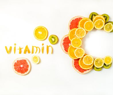 Vitamin C letters made of citrus fruits